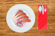 red fish on the plate over wooden background