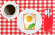 Scrambled eggs with bread on plate on color napkin and coffee cu