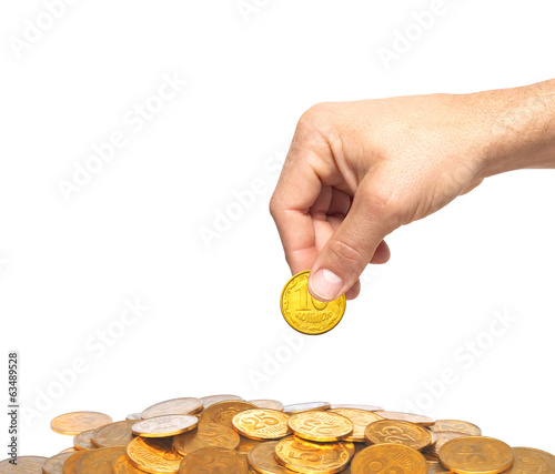 Many golden coins and man hand isolated on white background