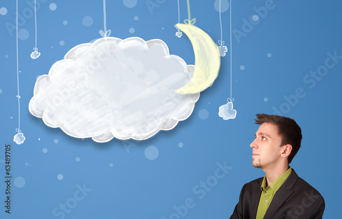 Businessman looking at cartoon night clouds with moon