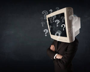 Businessman with a computer monitor head and question marks