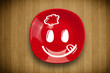 Happy smiley cartoon face on colorful dish plate