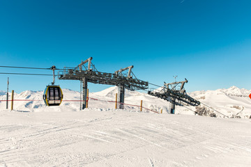 Cableway and chairlift in ski resort  in mountains, Austria
