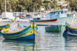 Traditional Luzzu boat at Marsaxlokk harbor in Malta. - 63491924