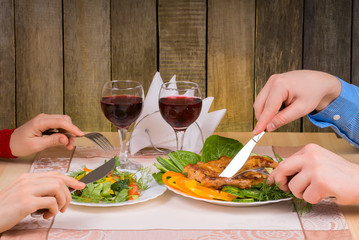 Couple having dinner in restaurant with rustic interior