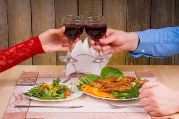 Lovely couple having romantic dinner in restaurant