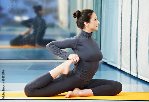 Happy smiling woman at gymnastic fitness exercise