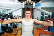 positive man at chest pectoral exercises machine