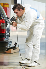 auto mechanic polishing car