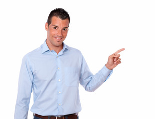Handsome adult man pointing to his left
