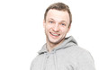Smiling Caucasian man in gray sports jacket with hood. Studio po