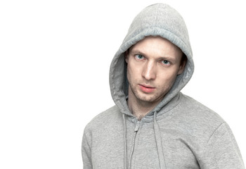 Young Caucasian man in gray jacket with hood. Portrait isolated