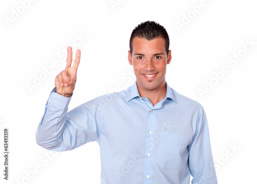 Cute young man with victory sign