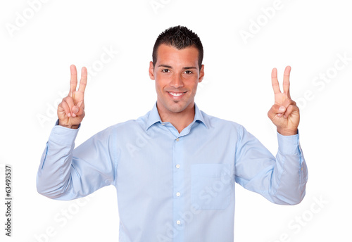 Gorgeous latin man with victory gesture