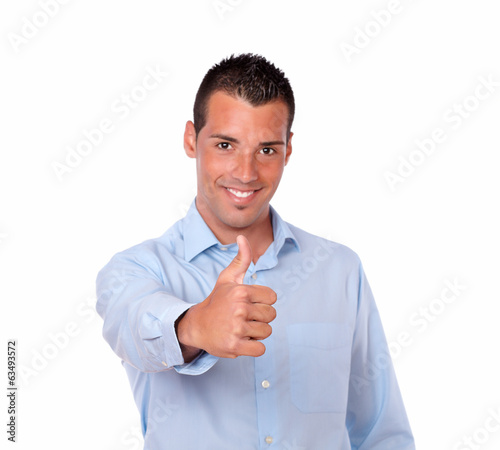 Handsome latin man with positive thumb sign