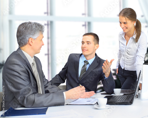 A business team sitting in office and planning work