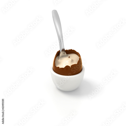Easter chocolate egg with vanilla cream filling and tea spoon