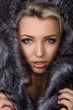 canvas print picture - girl in a fur coat
