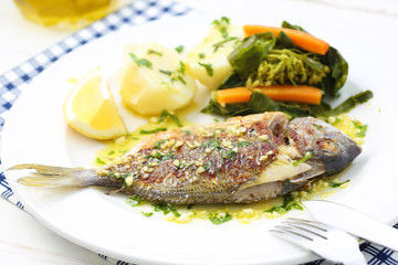 very fresh seabream fish grilled with turnip greens - traditiona