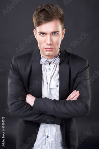 young attractive man in a jacket and bow tie