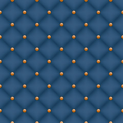 Seamless dark blue quilted background with golden pins.