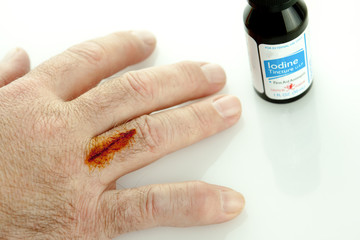 Iodine Bottle And Cut On Finger