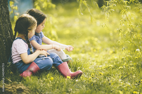 canvas print picture Two little girls at the farm