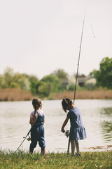 Two little girls at fishing