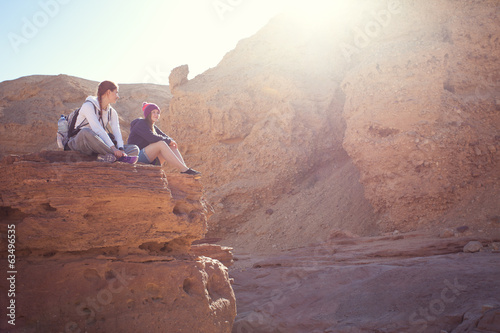 girls hiking on the rocks