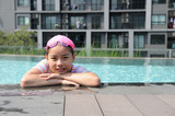 Asian girl has a happy time in swimming pool.