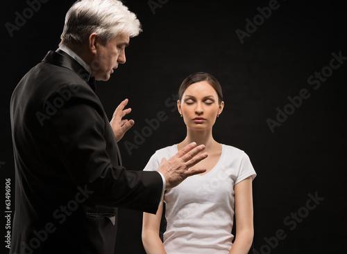 Alternative medicine therapist using hypnosis to heal his patien