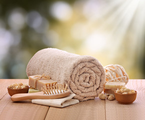 Outdoor spa setting with rolled towel and bath toiletries