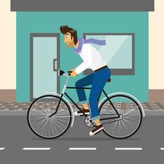 Handsome guy rides a bike