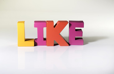Multicolored word like made of wood.