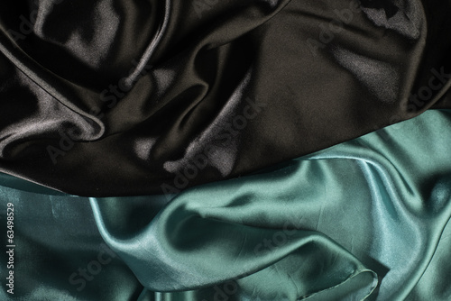 Shiny black and green satin fabric
