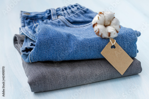 Stack of clothes with a sprig of cotton