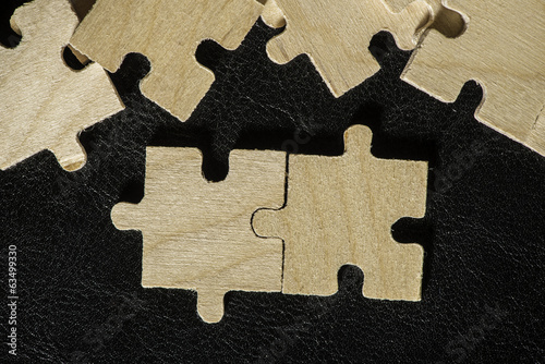 Wooden puzzle on black background
