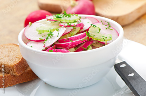 Radish salad in white bowl