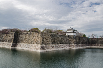 The moat and castle wall of Osaka city, Japan