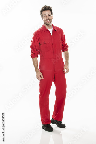 Full length portrait of a confident technician in a uniform