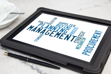 tablet with management word cloud