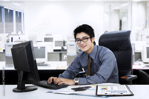 Asian businessman working at office