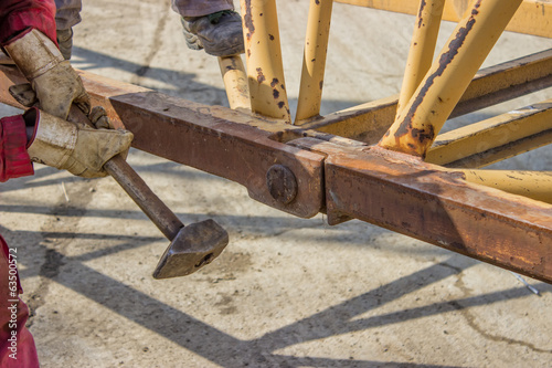 Construction worker holding hammer 3
