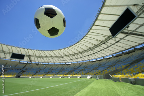 Football Soccer Ball Flying Over Stadium Green Grass Pitch