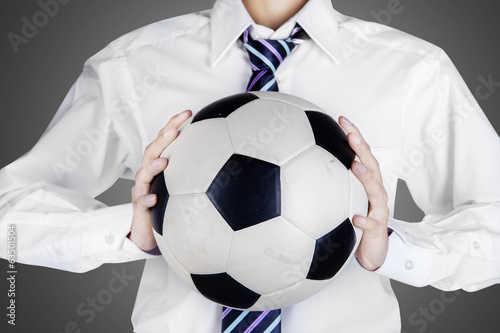 Businessman holding a soccer ball