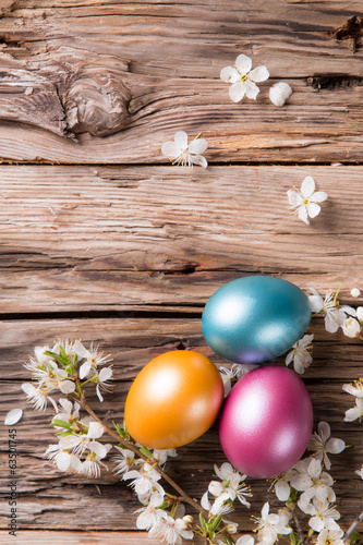 canvas print picture Easter colored eggs on wood