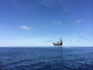 Oil and gas platform with beautiful blue sky