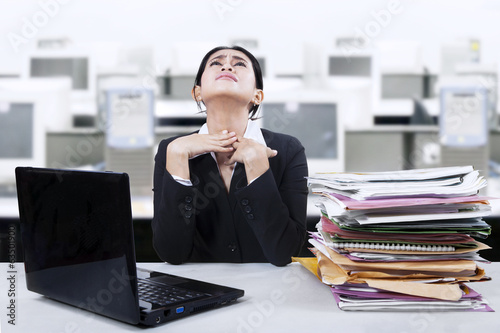 Businesswoman having sore throat