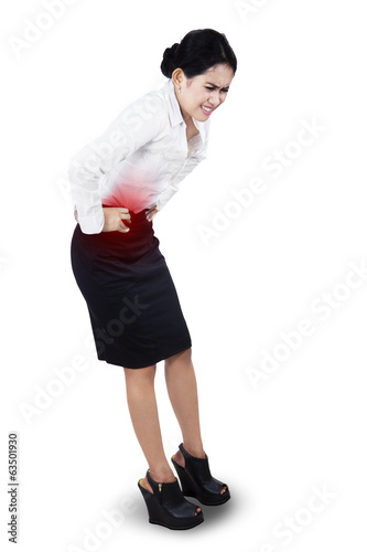 Businesswoman having stomach ache
