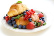 fresh croissant with berries for breakfast